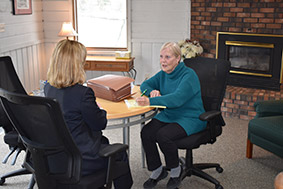 Attorney Ruth Harvey speaking with client