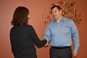 Attorney Chris J Carpenter shaking hands with client